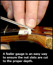 A feeler gauge is an easy way to ensure the nut slots are cut to the proper depth.